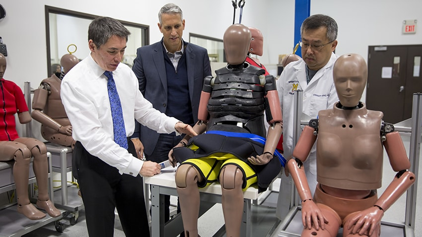 U-M trauma experts working with an obese crash test dummy