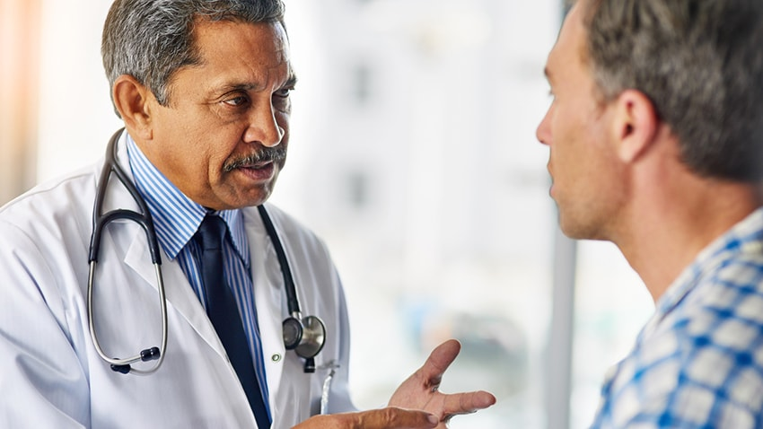 A doctor talking to a patient about prostate cancer