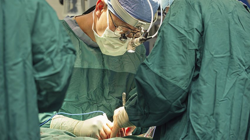Dr. Yang performing surgery