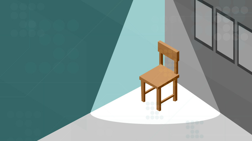 Image of brown solo chair in corner in spotlight