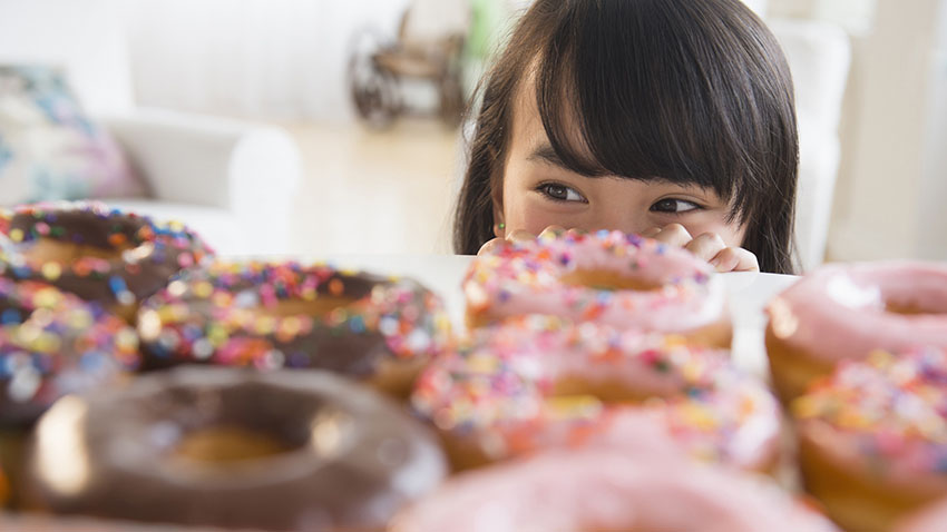 Girl looking at donuts