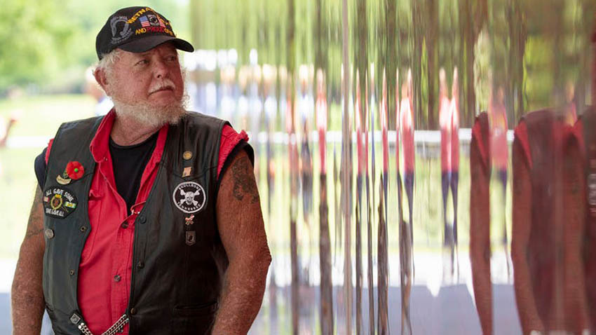 Vietnam veteran Marvin Nolin of Dover, Tenn., visits the Poppy Wall of Honor on the National Mall in Washington.