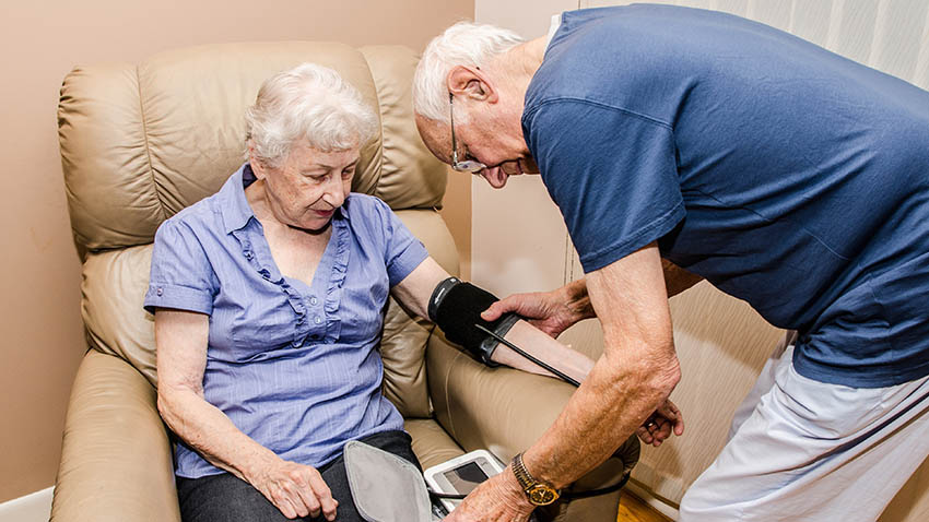 Older couple taking blood pressure