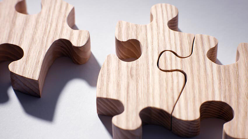Three wooden puzzle pieces
