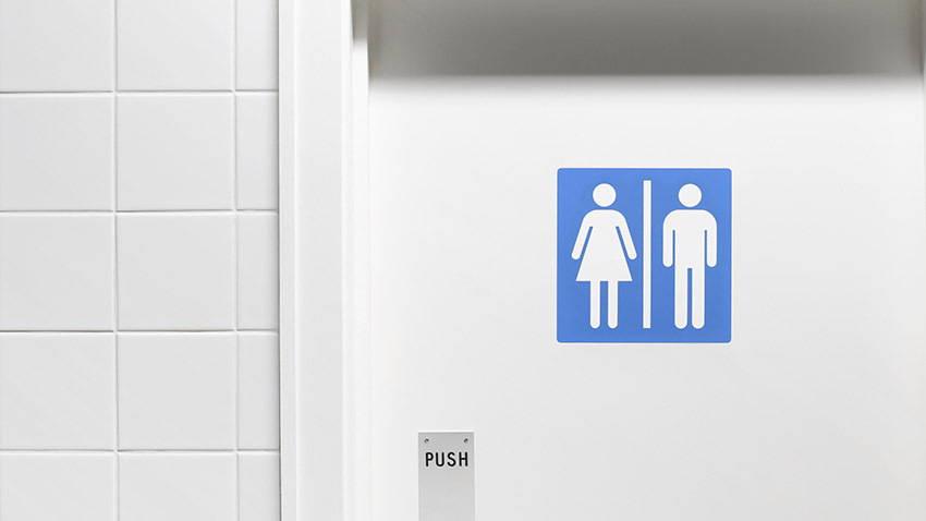 white bathroom door with blue gender sign
