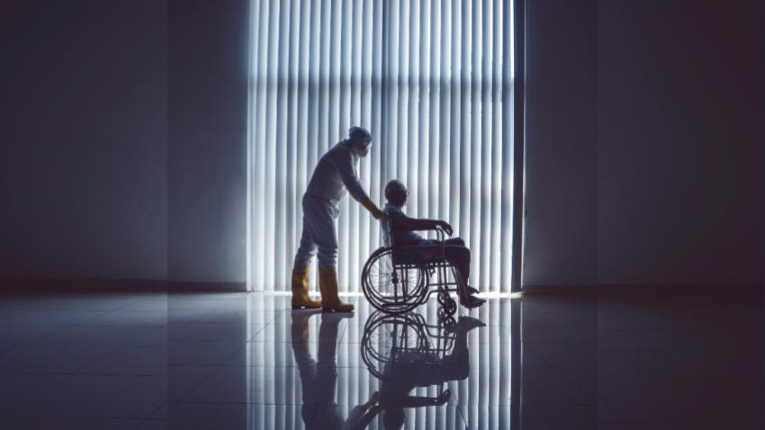 COVID_patient_being_pushed_in_wheelchair