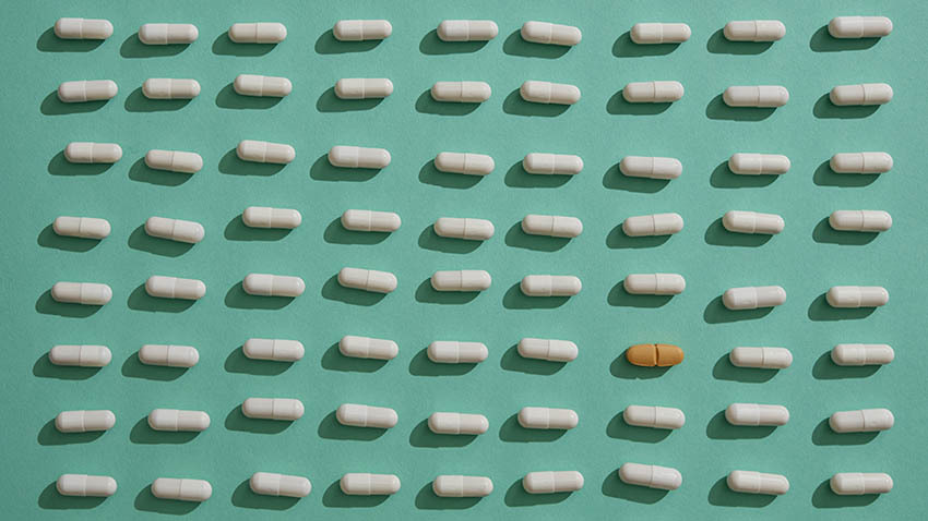 white brown pills on green background