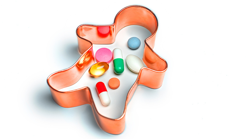 cookie cutter with pills inside in colorful colors