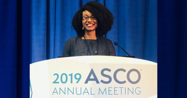 Christina Chapman MD at the speakers podium at the 2019 American Society of Clinical Oncology's annual meeting