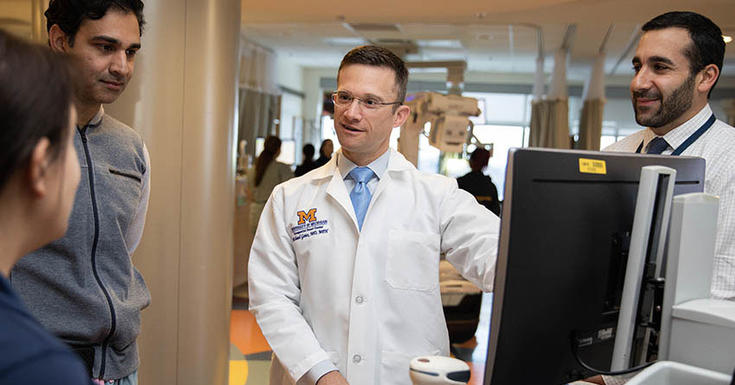 Doctor speaking with colleagues image
