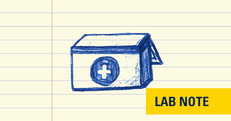 lined paper with blue ink drawing of an organ transplant box with words Lab Note on bottom right in yellow and blue