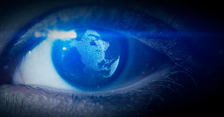 Pupil of eye with world map being reflected in the eye