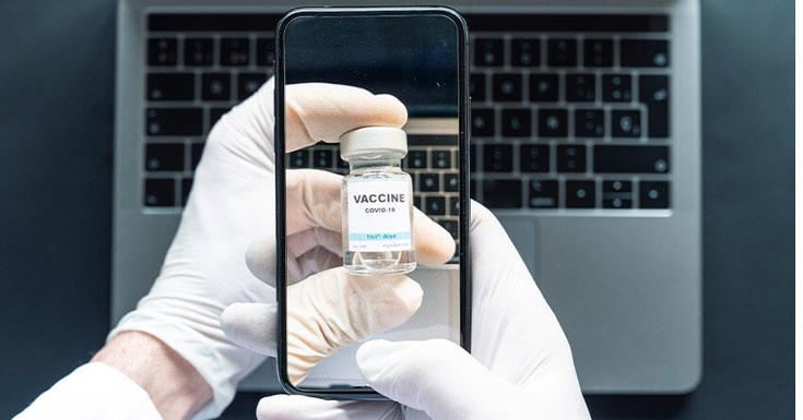 Iphone taking photo of vaccine