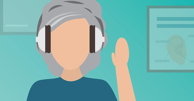 woman with grey hair with headphones on
