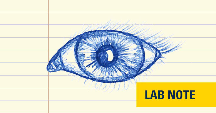 drawing in blue ink on lined paper of eye with lab note badge written out in yellow and navy blue bottom right corner
