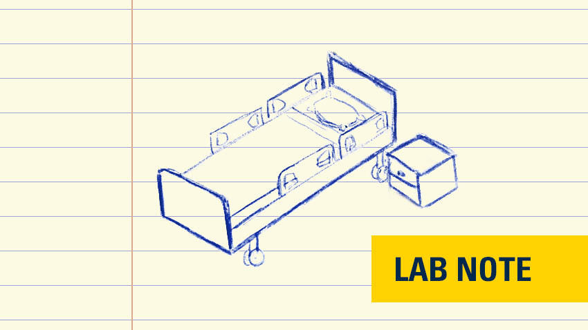 hospital bed drawn in blue ink with badge on bottom right saying lab note in yellow